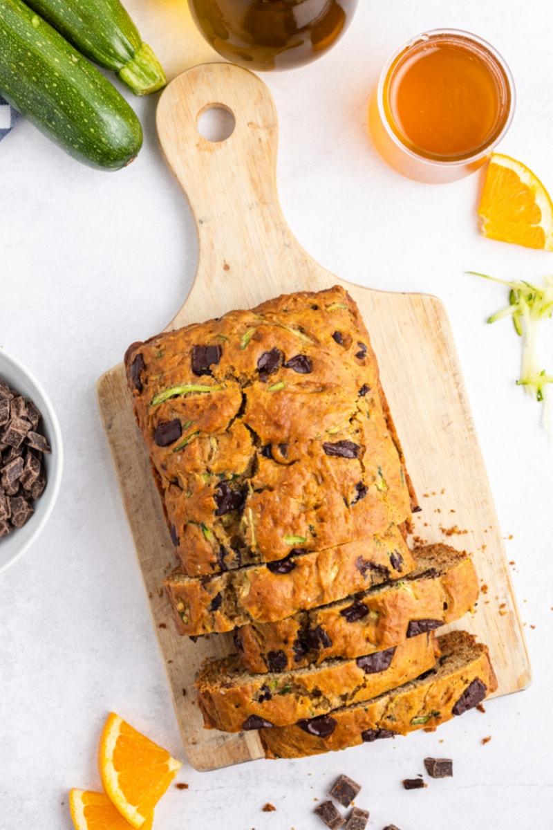 loaf of chocolate chunk zucchini bread on bread board